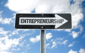 Entrepreneurship direction sign with sky background
